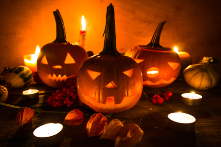 Halloween pumpkins with cut faces and candles photo