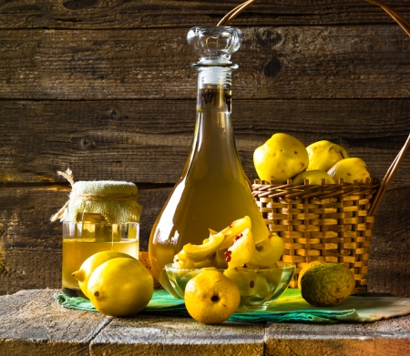 Tincture of quince and fruit on a wooden table photo