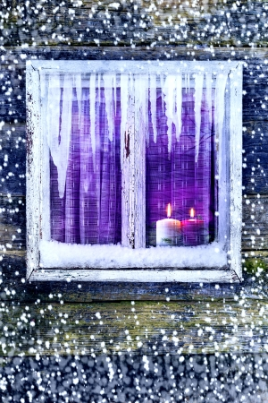 Lit candles in the window. Time Christmas and New Year photo