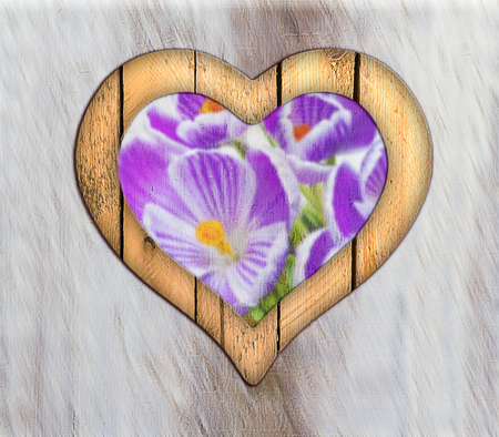 Wooden border of hearts shape on the wooden wall with view from flowers photo