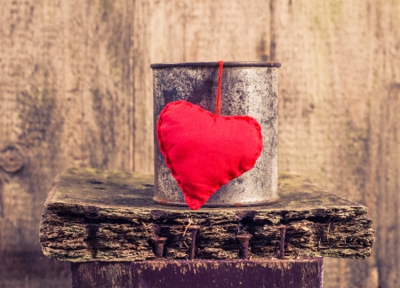 Heart hung on a rusty tin photo