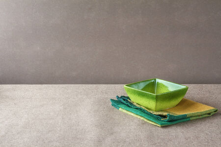 textille: Empty bowl with napkin on a grunge background
