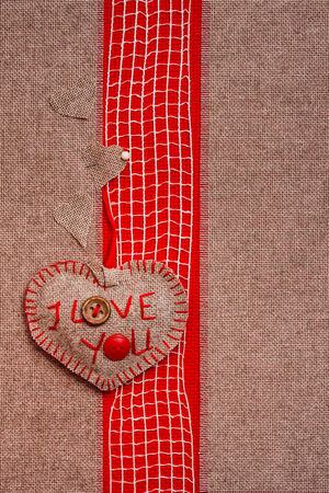 Valentine background with hand-sewn heart with word I love You photo