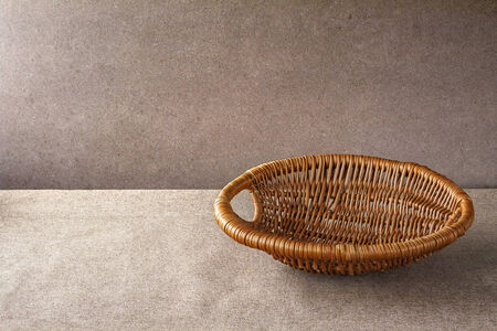 backing: Empty wooden basket on a grunge background
