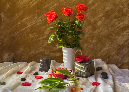 Still life with a bouquet of roses, hearts and cherries photo