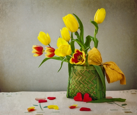 Still life with a bouquet of tulips and hearts photo