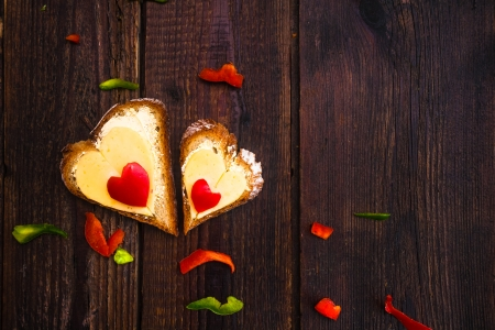 Valentine sandwiches for breakfast for lovers on wooden background photo