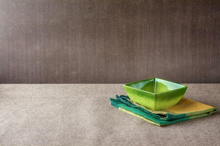 textille: Bowl with napkin on a grunge background