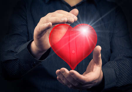 Valentine heart in the hands of a man photo