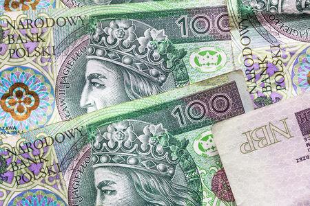 Money background with stacked many Polish banknotes photo