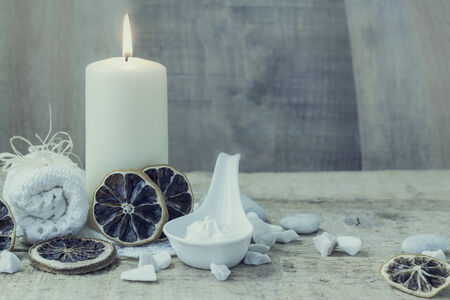 Spa and wellness setting with candle and towel