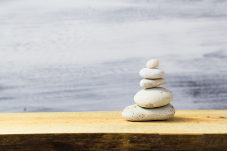 Pyramid of zen stones on a wooden board photo