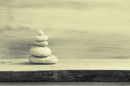 Pile of zen stones on a wooden board photo