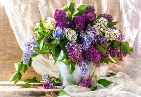 Still life with sprigs of lilac thriving Фото со стока