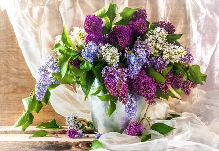 Still life with sprigs of lilac thriving Standard-Bild