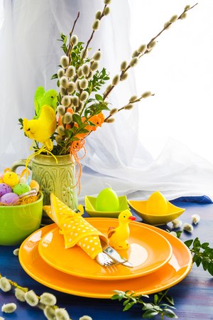 Easter table setting with a bunch of willow catkins
