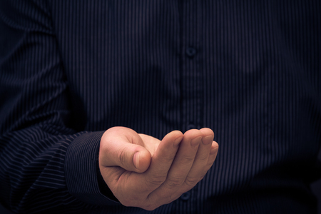 beg: Hand in a gesture of holding something or ask for help Stock Photo