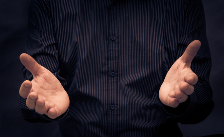 body dimensions: Man gesturing during a speech or showing something Stock Photo