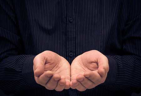 beg: The mans hands in a gesture of holding something or ask for help