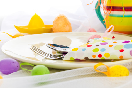 Cutlery wrapped in a napkin on Easter table