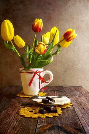 Still life with a bouquet of tulips photo