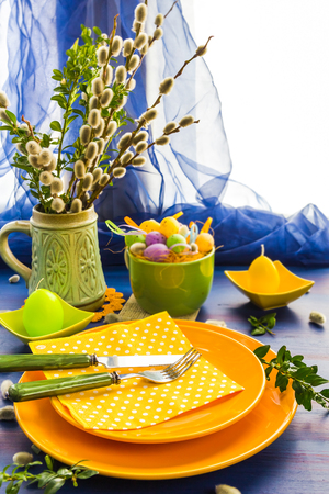 Easter table setting with a bunch of willow catkins Фото со стока