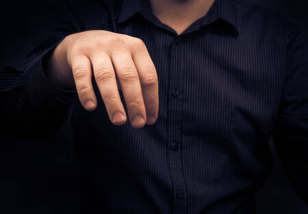 Hand of a man holding some gadget or something disgusting