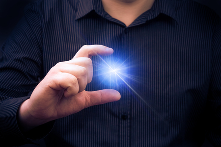 Mysteriously emitting power in the hand of a man Standard-Bild