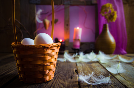 Vintage Easter basket with eggs and feathers photo