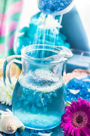 Preparing for a relaxing spa bath: aromatic pouring salt photo