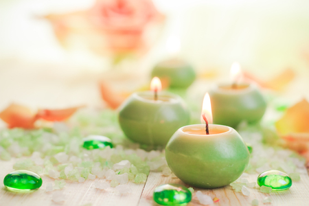 A few burning candles and salt spa Stock Photo