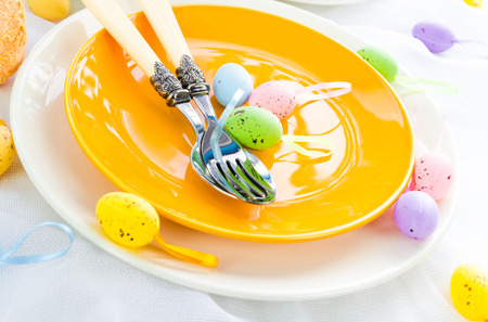 Closeup of Easter place setting with eggs photo