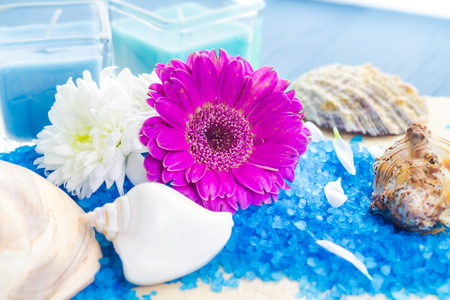 Spa set with bath salt and flowers photo