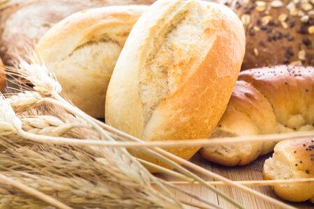 Different bakery products including bread rolls with grain photo