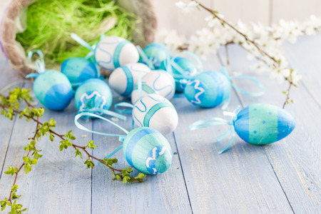 View of the scattered Easter eggs and spring branches photo