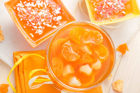 Tasty fruit jelly with slices of orange photo