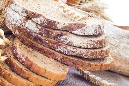 Loaf of bread sliced with crispy rolls Standard-Bild
