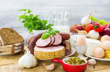 Composition with variety of grocery products including meat and dairy photo