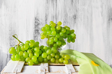 Still life with fruit and a bottle of wine grapes photo