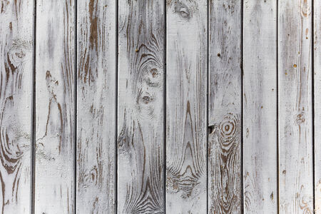 The wall of wooden planks painted in white