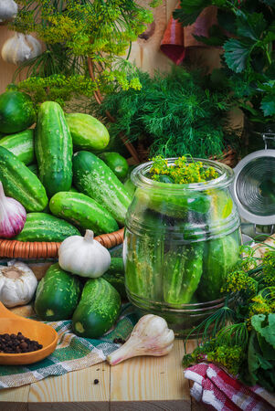 preserving: Jar of pickles and other ingredients for pickling