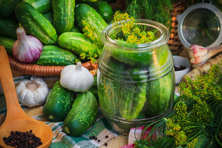 Jar of pickles and other ingredients for pickling photo