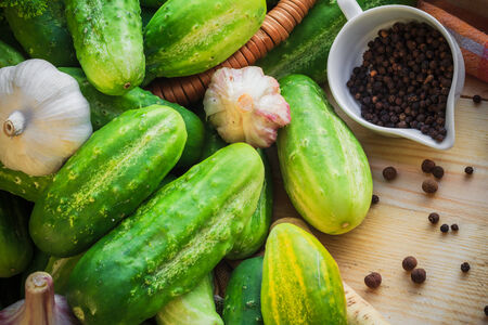 The ingredients for the preparation of pickled cucumbers photo