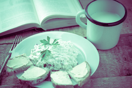 Cottage cheese with bread and a cup of fresh milk photo