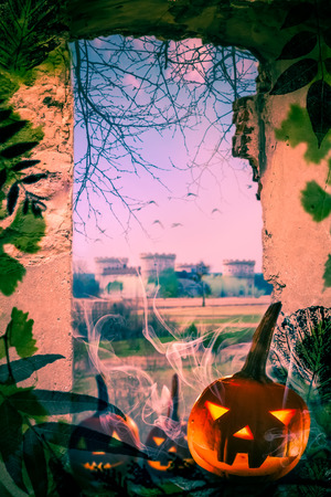 window view: Halloween project: pumpkins in the old ruins. View from the window of the old castle.