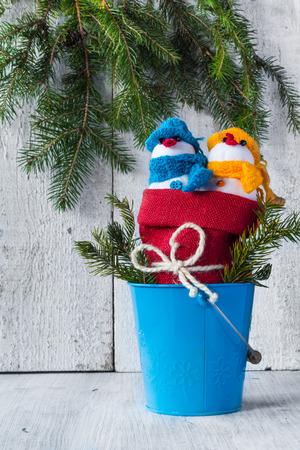 Plush soft snowmen on white wooden background photo
