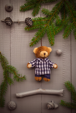 Christmas setting: the composition of the gifts of the forest and teddy bear photo