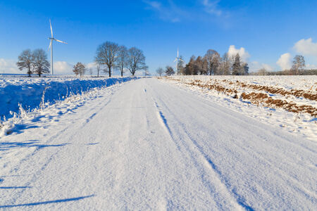 covered fields: Winter landscape with road and snow covered fields and windmills