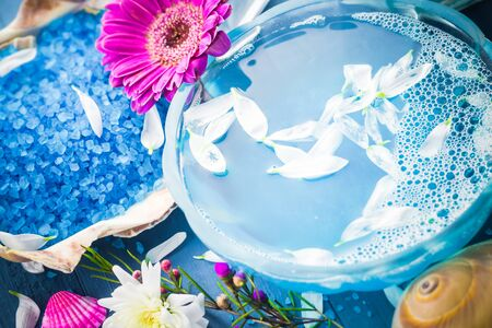 blue flowers: Spa composition: water and bath salt, shells and flowers Stock Photo