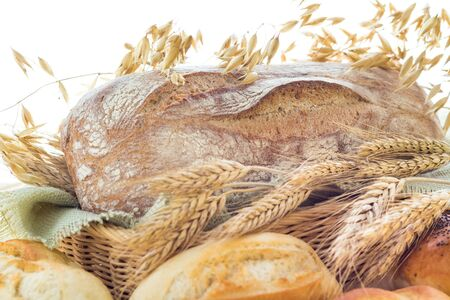 Ears of grain between the bakery products photo